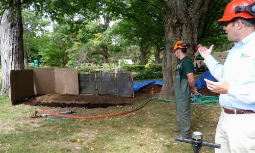 Again, the arborists set up barriers to limit the area affected by blown-out soil and pebbles.  Rolf Briggs (right foreground) showed how to use a compaction meter, and explained that the green flags delineate the area to be decompacted.  Flagging the area for review by the client makes the limit of work clear to all parties.